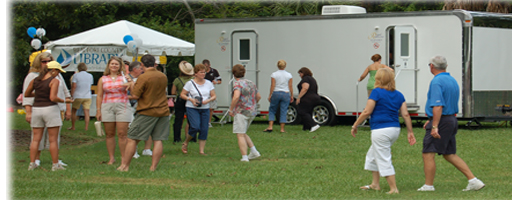 Festival using portable upscale mobile restroom trailer, portable shower trailer and ADA toilet trailer